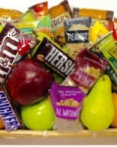 fruits,coffee,chocolate & snack in a basket